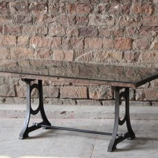 Ashta Sleeper Dining Table with Glass Top